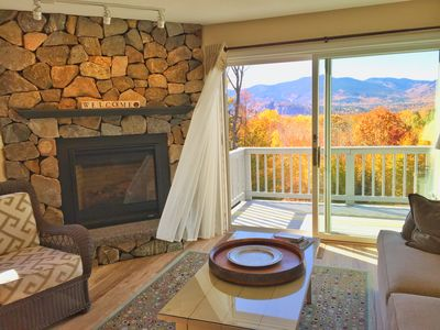 Living room with deck and fabulous mountain views.