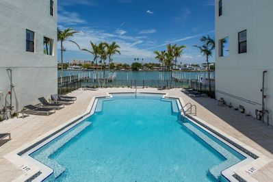 The pool and jacuzzi  are a great w/ water view