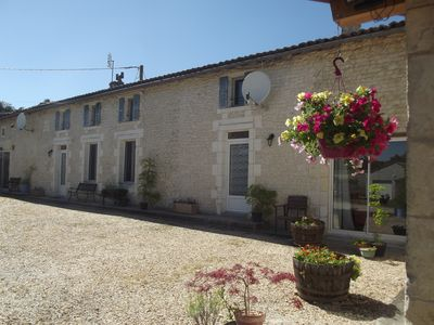 Photo for Comfortable farmhouse with a shared heated pool at the edge of a village