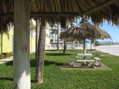 View in the front with Tiki Huts, beach, Swimming Pool, Pier Entry  from the BBQ