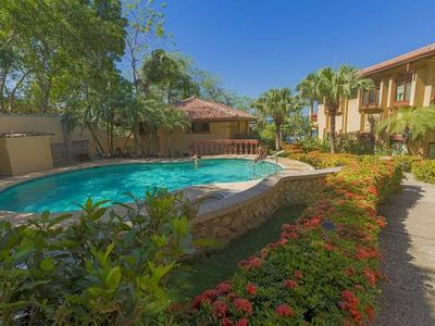 Photo for Cozy ground floor condo- shared pool, near beach, kitchen, a/c, cable