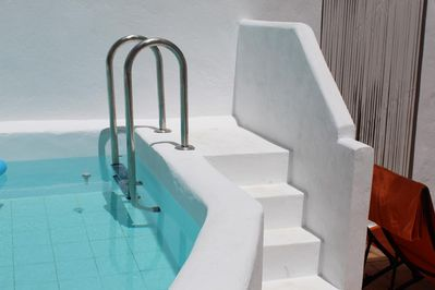 Steps to the onsite communal pool located in the secluded courtyard