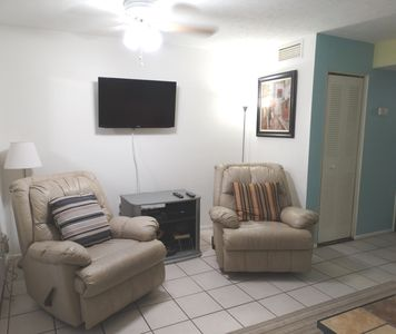Lounge showing SMART TV and 2 Lazy Boy Chairs