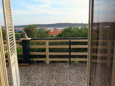 Photo for One bedroom apartment with terrace and sea view Barbat, Rab (A-4988-b)