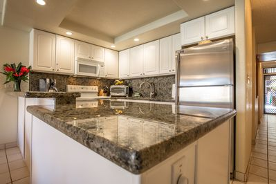 Well Equipped Kitchen With Granite Counters