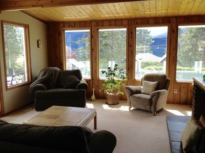 Cozy upstairs living room with views of the lake and mountains.