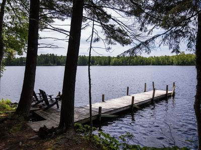 Photo for Private Hayward  Log Cabin Lodge, Secluded, 3 Docks, 8 acres Endless Shoreline