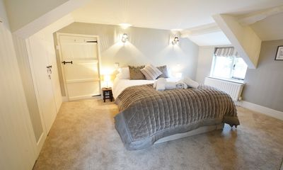 Photo for Perrymans Thatched Cottage | Climbing Frame | Beach Pass | Log Burner | Dogs