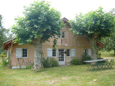Photo for In the middle of the Landes forest quiet renovated charming farmhouse