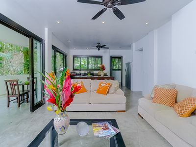 Photo for NEW LISTING! Contemporary ground-level suite w/large patio, walk to the beach