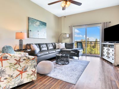 Photo for Dog Friendly bay front condo, shared pool and hot tub right next to the beach!