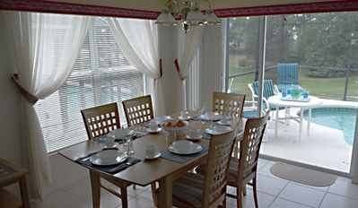 Dining area with walk out to the pool