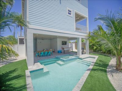 Photo for THANKSGIVING WEEK STILL AVAILABLE! BOOK TODAY!!  STUNNING BRAND NEW 7 BEDROOM HOME WITH PRIVATE POOL AND SPA, ARCADE ROOM, CUSTOM OUTDOOR TIKI BAR WITH 2 TVS. SHORT WALK TO THE BEACH AND HISTORIC BRIDGE STREET!!