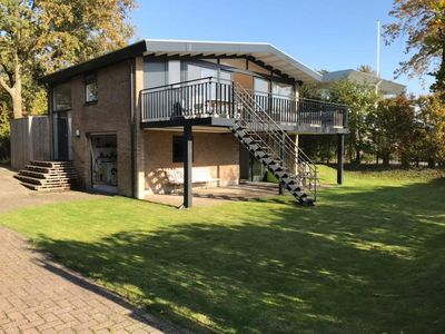 Photo for Spacious villa at Veerse lake with sunny garden and privacy