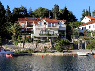Photo for Two bedroom apartment with terrace and sea view Vrboska (Hvar)
