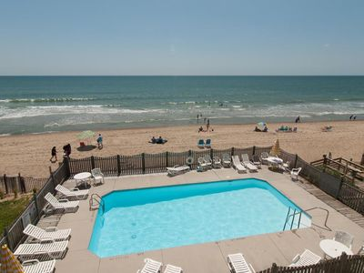 Photo for Overlook both the pool and the sandy beaches from this oceanfront condo