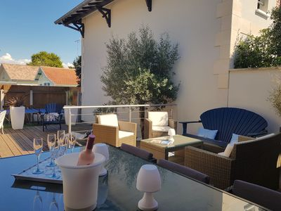 Photo for Charming family villa with delicious patio just steps from the Market