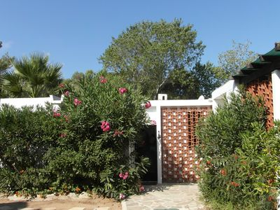 Photo for Fully equipped air conditioned villa for two by sandy beach with beautiful views