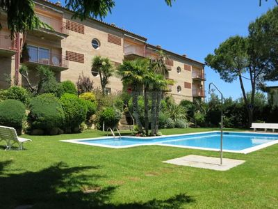 Photo for Comfortable apartment with garden and communal pool
