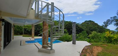 Photo for New home nestled between beach and mountains with 360° views and infinity pool