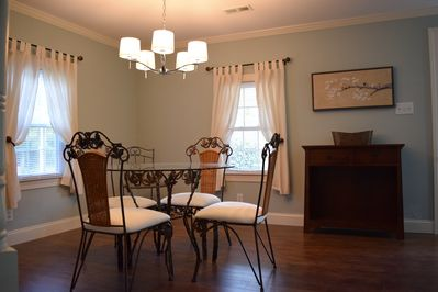 Dining room has seating for four.