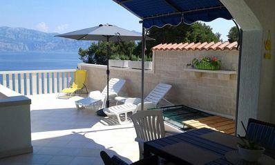 Photo for Two bedroom apartment near beach Postira (Brač) (A-706-a)