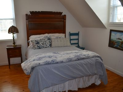 Upstairs SW Bedroom Featuring A Victorian Theme And Full Size Bed