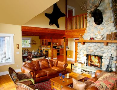 Great room complete with stone fireplace and 'moose'.