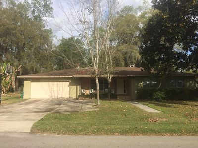 Photo for Lovely mid-century home.1.8 miles to UF. Located on quiet cul-de-sac.