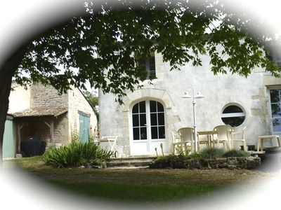 Facade of L'Authentique, 18th century stone house renovated, overlooking the estuary.
