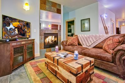 Living room - equipped with comfortable seating, fireplace, and flatscreen