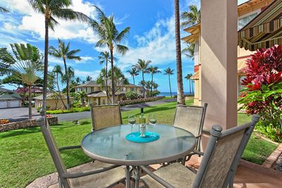 Lanai with glass topped table and chairs.