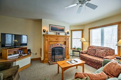 The main living room hosts a cozy gas fireplace and a flat-screen cable TV.