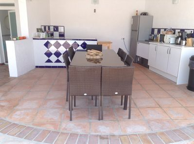 outside kitchen area with fridge freezer and bottle fridge, dish washer, kettle,