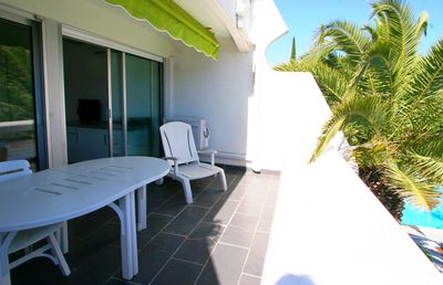 Photo for Two bedroom air-conditioned cabin with beautiful terrace with pool