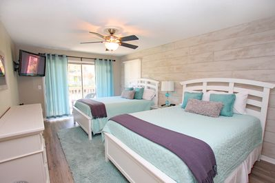 Bedroom one with fun shiplap wall