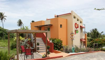 photo of building from parking lot: Fusion Beach Villas in Isabela, PR