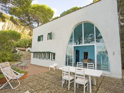 Photo for Beautiful independent villa in the Mediterranean vegetation and overlooking the crystal clear waters of the beach of Seccione