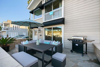 Cozy outdoor living space with gas BBQ