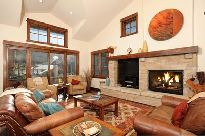 The large windows let in lots of natural light to the living room