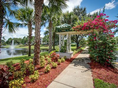 Photo for Modern condo with community beach-style pool in gated resort near Disney!