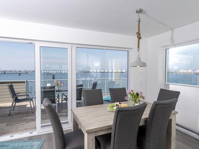 Photo for Duplex holiday property in the first row to the water - Immediate proximity to the Weidefelder sandy beach - Central location to the harbor promenade of the OstseeResort Olpenitz - Two terraces - Woodburning stove - Free Wi-Fi