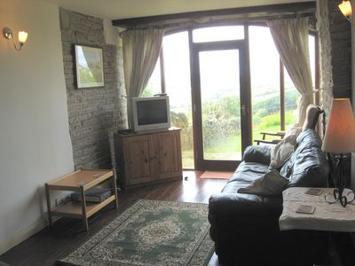 The lounge - with stunning views across farmland towards the Flyde Coast
