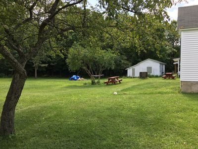 Backyard with Fire Pit and Picnic Tables