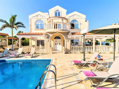 Photo for Exclusive three floor villa with five bedrooms on the seafront