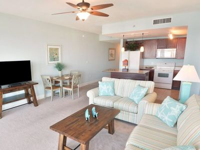Photo for Remodeled beach condo close to attractions with shared pool and hot tub!