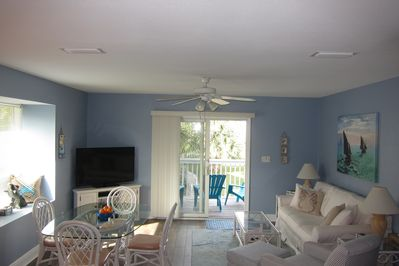 Entertaining room with 50' flat screen television and deck with ocean view.