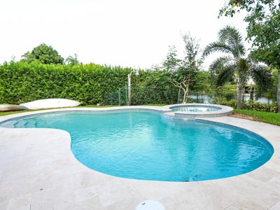 Photo for COMFORTABLE & FUN HOME ON CANAL W/FISHING, JACUZZI & POOL-NEAR BEACH/GREAT SHOPS