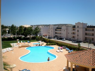 Large pool, children's pool and attractive paved area in front of the apartment