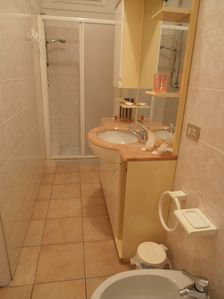 BATHROOM WITH SHOWER AND HAIRDRIER